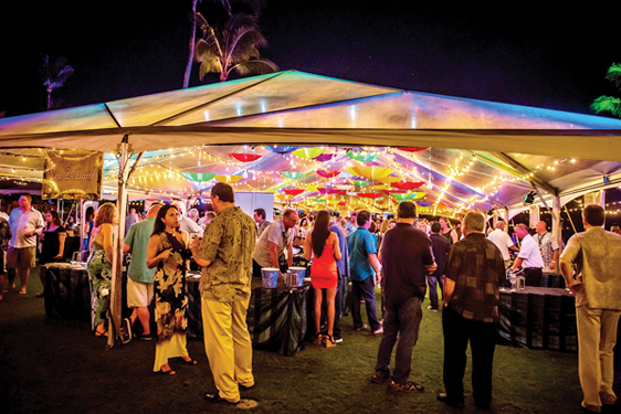Socializing is a big part of the fun at the Grand Tasting, situated oceanfront at the Montage Kapalua Bay on Friday.  • KAPALUA WINE & FOOD FESTIVAL photo