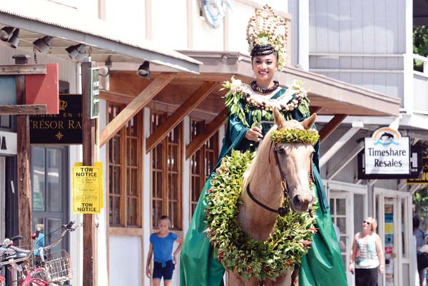 Camille Akana and flower bedecked horse in the 2015 Na Kamehameha Commemorative Pa'u Parade &Ho'olaule'a in Lahaina.  Photo courtesy Daryl Fujiwara