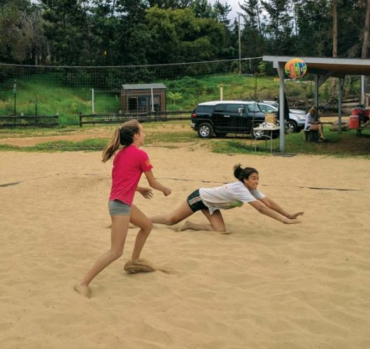 A.J. Ashoff dives for a ball in front of Malia Bennett during an Aloha Volleyball match Saturday in Kula. Ashoff and Bennett finished second in the 14-and-under division, and Ashoff teamed with Ella Connor to take first place in girls 18. SCOTTIE ZUCCO photo
