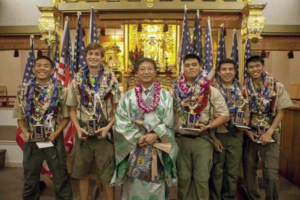 New Eagle Scouts are Dyllon Oishi-Mochida (from left), Ian Roth, the Rev. Shinkai Murakami, Mitchell Grey, Isaac Kaleo Pena and Wesley Sakutori.