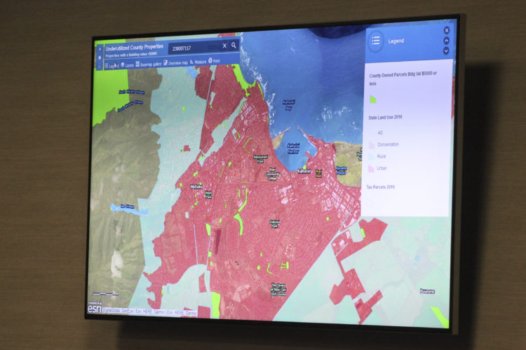 A sample of the map's features is shown on a screen during Tuesday's meeting. Users can view county-owned property, nearby infrastructure, bus stops and more. Maui County Chief Technology Officer Jacob Verkerke said he hopes the map would be finished within the next month. • The Maui News / COLLEEN UECHI photo