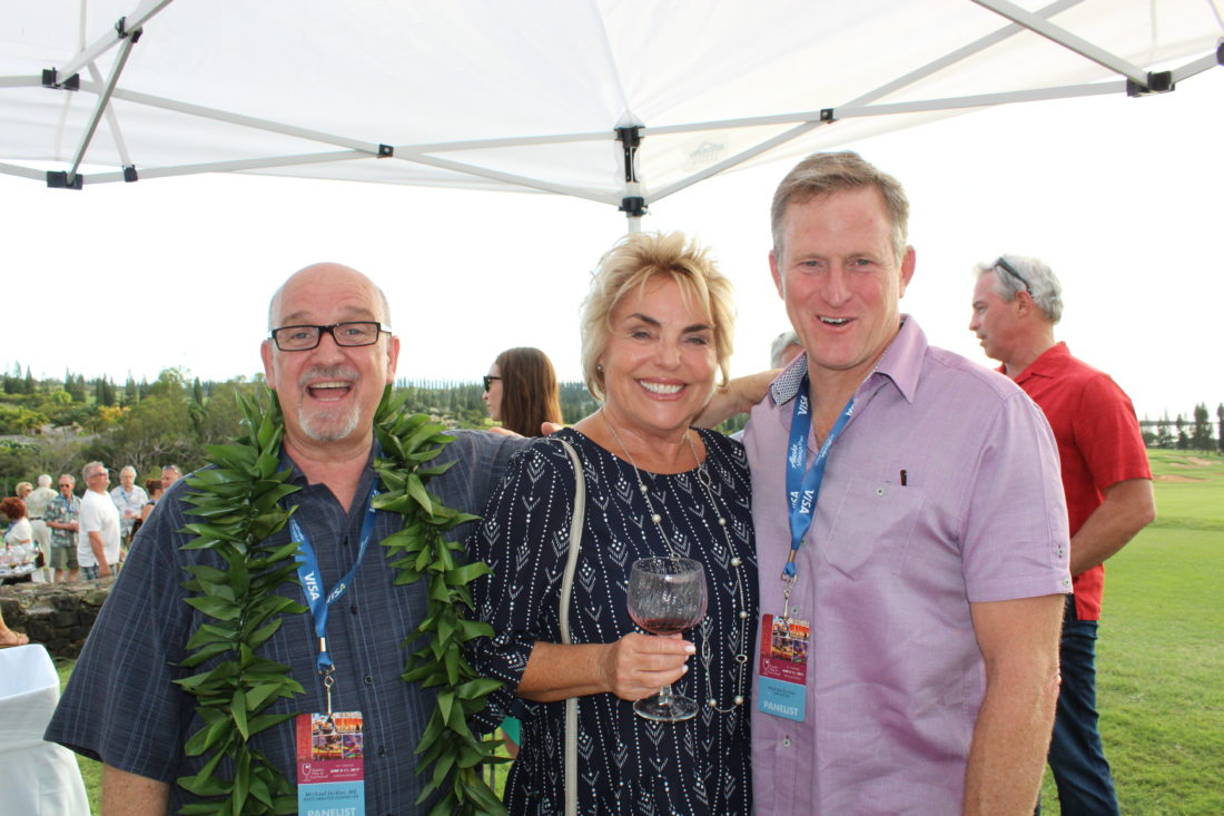 Kapalua Wine & Food Festival host and master sommelier Michael Jordan (left) and celebrity chef Andrew Sutton of Napa Rose at Disneyland in Anaheim, Calif., flank attendee Shelley Kekuna. •The Maui News / CARLA TRACY photo