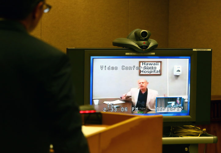 Deputy Prosecutor Andrew Martin listens to state psychologist Alex Lichton testify via video Wednesday afternoon in 2nd Circuit Court. • The Maui News / CHRIS SUGIDONO photo