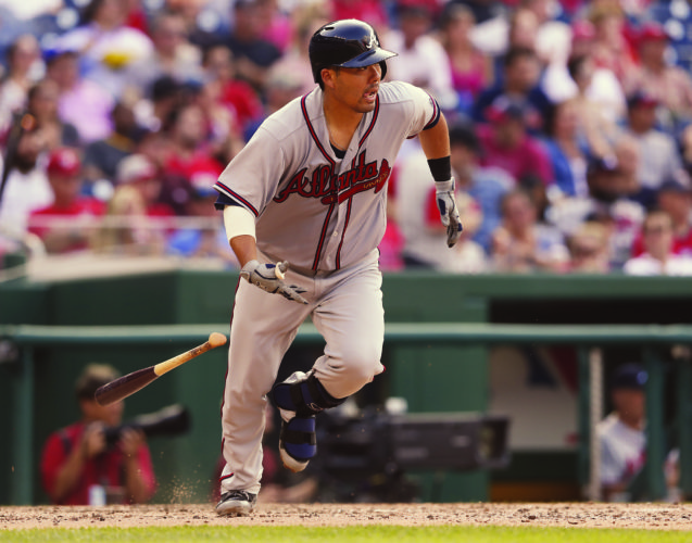Kurt Suzuki of the Atlanta Braves runs to first base after hitting a single in the seventh inning Wednesday.  • AP photo
