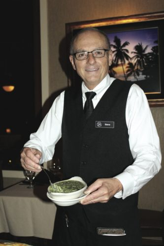 Veteran server Steve Christner of Ruth's Chris Steak House in The Shops at Wailea serves   world-famous creamed spinach. • The Maui News / CARLA TRACY photo