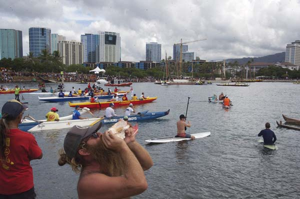 The Polynesian Voyaging Society's sailing canoe Hokule'a arrives at Magic Island on Saturday. -- AP photo