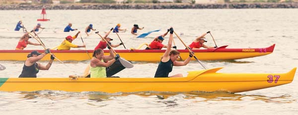 Lae'ula O Kai's women's 55 crew leads en route to its second victory of the season Saturday, crossing the finish line in 5 minutes, 2.70 seconds at Kahului Harbor.  -- The Maui News / CHRIS SUGIDONO photo