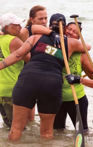 Lae'ula O Kai's Lei Laanui (back) hugs Vannassa Au-Haupu after their win. -- The Maui News / CHRIS SUGIDONO photo