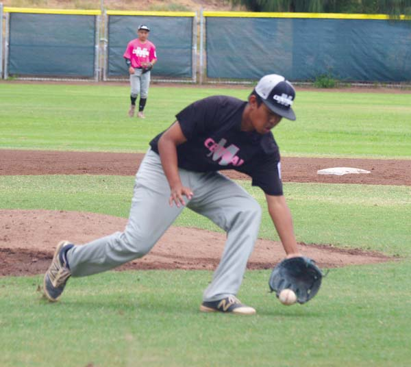 Central pitcher Kaimana Benjamin fields a ground ball back to him in the fifth inning. -- The Maui News / BRAD SHERMAN photo
