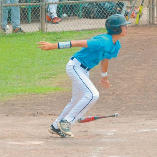 Upcountry's Spencer Holl heads out of the batter's box on the way to a fourth-inning single during Sunday's Hawaii State Little League District III Junior Division tournament game. The Maui News / BRAD SHERMAN photo