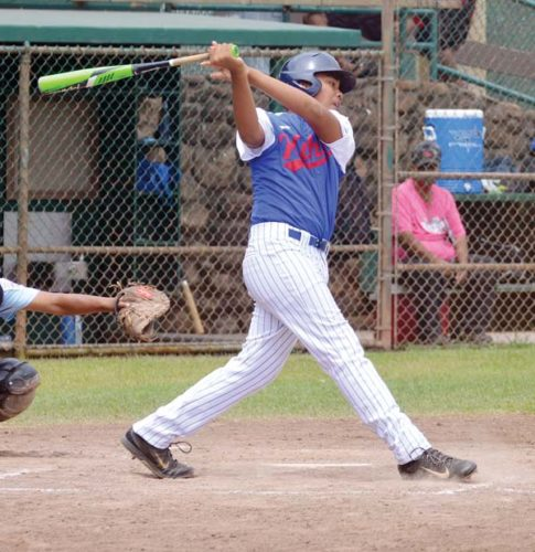 Kihei's Aizeah Lakalaka follows through on an RBI fielder's choice in the third inning of Monday's Junior Division district final. The Maui News / BRAD SHERMAN photo