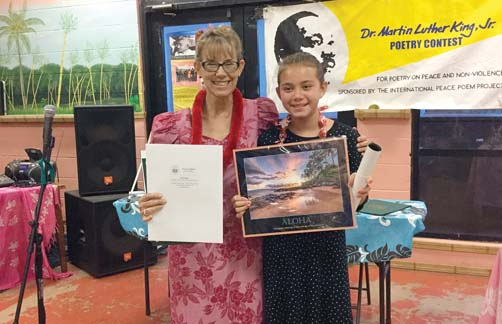 Fifth-grade student Carly Dudoit from Kualapuu Public Conversion Charter School receives recognition for her grand prize award-winning poem in the 18th annual Dr. Martin Luther King Jr. Peace Poetry Awards at the Molokai Youth Center. She is shown with contest director Melinda Gohn. -- International Peace Poem  Project photo