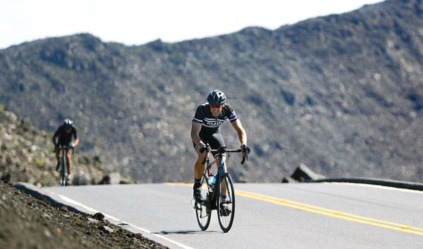 Dave Smith of Kula approaches the Cycle to the Sun finish line at the Haleakala summit Saturday on the way to placing sixth in the men's 40-49 division. -- The Maui News / CHRIS SUGIDONO photo