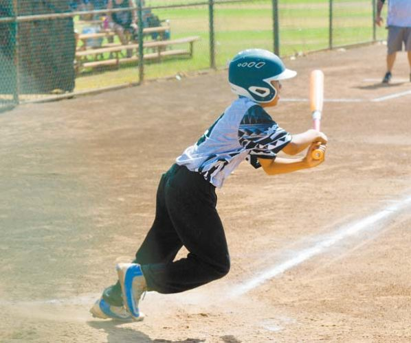 Duke Aloy of Central East Maui heads out of the batter's box on the way to a double in a win over West Maui on Sunday in the District III Little League Minors Division tournament. The Maui News / BRAD SHERMAN photo