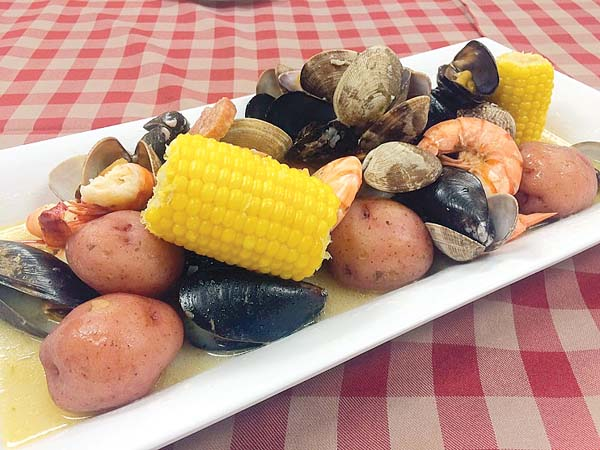 Savor crowd-pleasing clams, corn on the cob, shrimp, mussels and more. Photo courtesy Sheraton