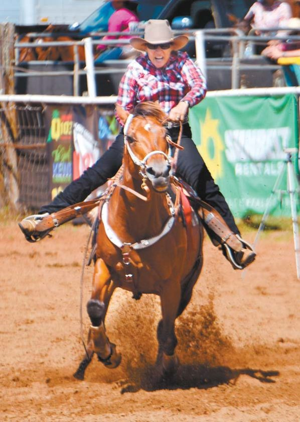 Sharon Freitas charges to the wahine barrel racing title — she had a time of 18.32 seconds. The Maui News / MATTHEW THAYER photo