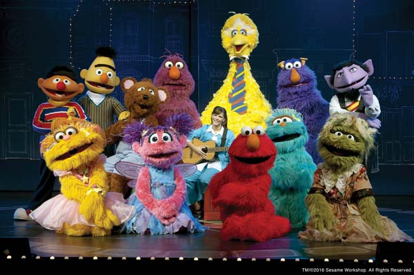 """Elmo (red center) and the Sesame Street gang help the new music teacher find her missing instruments in """"Sesame Street Live: Elmo Makes Music."""" Photo courtesy Sesame Workshop"""