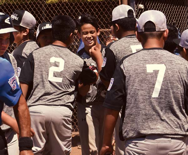 Haokea Kekahuna-Tomita is congratulated by teammates after his three-run homer gave Central East Maui a 10-0, four-inning win over Kihei on Wednesday in the Hawaii State Little League District III Majors (11-12) Division title game at Dorvin Leis Field. The Maui News / MATTHEW THAYER photo