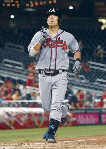 The Braves' Kurt Suzuki celebrates after hitting a home run in the sixth inning Thursday. AP photo