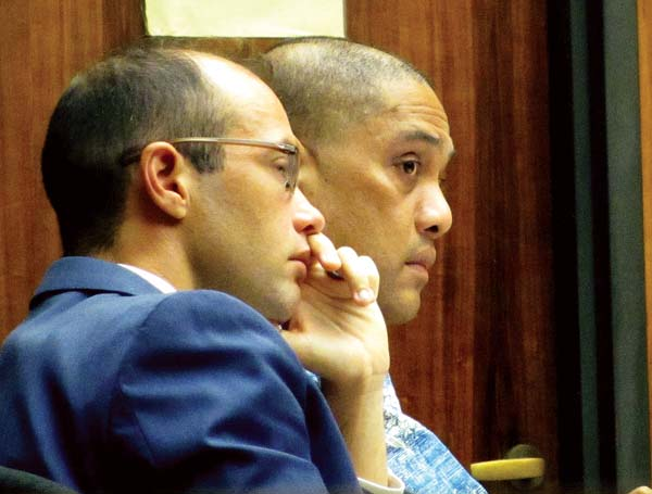 Former Maui Community Correctional Center guard James Siugpiyemal (right) sits with his attorney, Ben Lowenthal, on Tuesday afternoon in 2nd Circuit Court. Siugpiyemal is on trial on charges of sexually assaulting an inmate in 2014. The Maui News / LILA FUJIMOTO photo