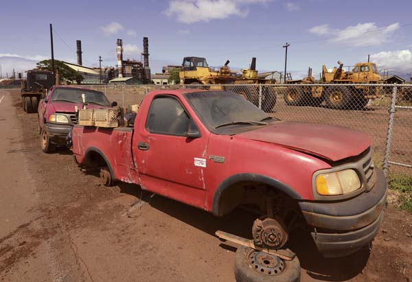 This truck still was at Puunene Mill on Thursday as buyers of Hawaiian Commercial & Sugar Co. equipment claimed items bought at auction. Last month's auction was the last time the old sugar company's assets will be on the auction block. The Maui News / MATTHEW THAYER photo