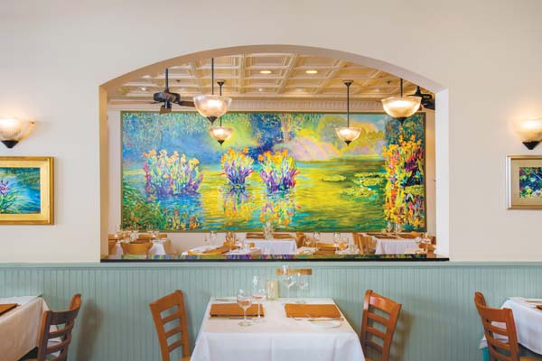 A Jan Kasprzycki painting inside an archway highlights the decor in the Lahaina hot spot. Lahaina Grill photo