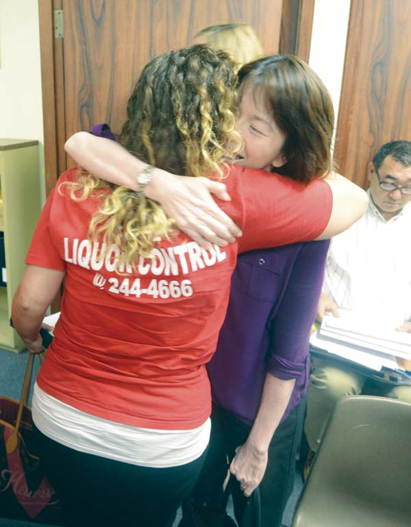 Mahina Martin is hugged by Ashlee Chapman after the Maui County Liquor Control Commission's decision Wednesday morning to reverse course on controversial changes it made earlier this year. The panel voted to reinstate the 11 p.m. to 6 a.m. blackout on retail liquor sales and the cap of 12 hostess bars in the county. The Maui News / MATTHEW THAYER photo