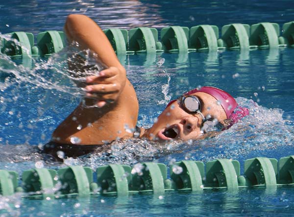 Jasmine O'Brien of Hawaii Swim Club heads to a win in the girls 15-16 1,500-meter freestyle at the state long-course swimming championships Thursday at Kihei Aquatic Center. The Maui News / MATTHEW THAYER photo