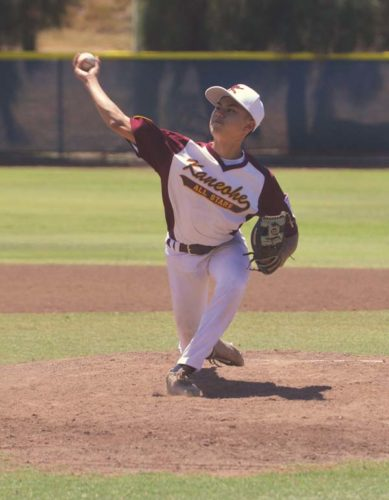 Logan Albinio pitches for Kaneohe in the third inning of the Oahu squad's 13-3 victory over West Side Hawaii in the opening game of the Hawaii State Little League Junior (13-14) Division state tournament on Friday at Maehara Stadium in Wailuku. -- The Maui News / BRAD SHERMAN photo