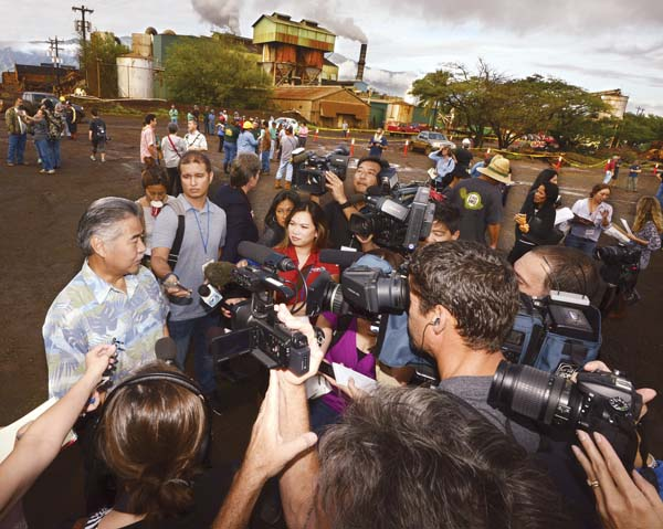 Gov. David Ige speaks to reporters Dec. 12 outside the now-shuttered Puunene Mill. He was among officials to see the last haul of sugar cane from the fields. The governor has been making a greater effort to be visible on the Neighbor Islands as recent polls have cast doubt on his re-election chances in 2018. -- The Maui News / MATTHEW THAYER photo