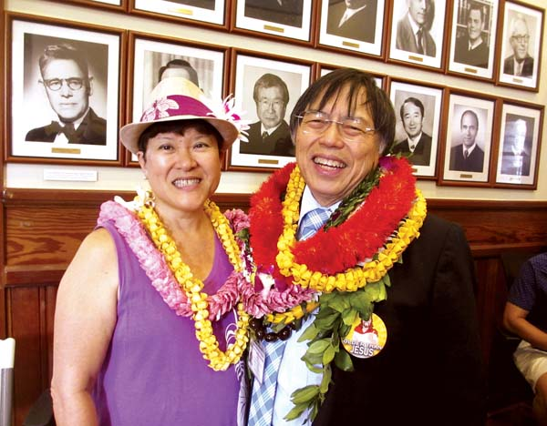 John Tam and his wife, Maysie, celebrate his retirement during a lunch last month in the Old Wailuku Courthouse, which now houses the prosecutor's office. The building served as the county courthouse when Tam began his career as a deputy prosecutor more than 40 years ago on  Feb. 1, 1977. -- The Maui News / LILA FUJIMOTO photo