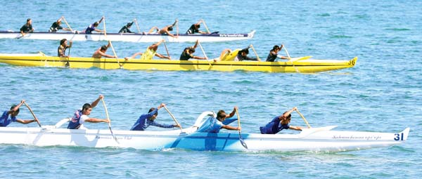 Hawaiian Canoe Club's boys 13 crew leads Napili and Na Kai Ewalu en route to a win Saturday at the John M. Lake Regatta at Kahului Harbor. -- The Maui News / CHRIS SUGIDONO photo
