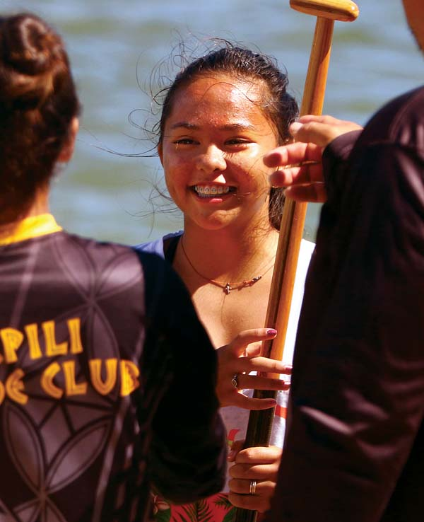 Napili Canoe Club's Taryn Cabingas celebrates with teammates after her crew won the girls 13 race. -- The Maui News / CHRIS SUGIDONO photo