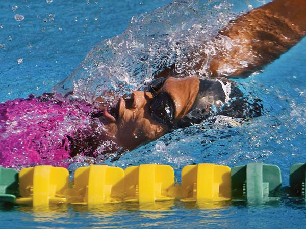 Hawaii Swim Club's Kysha Altura heads to a second-place finish in the girls 17-18 200 individual medley during Saturday's state long-course swimming competition at Kihei Aquatic Center. -- The Maui News / MATTHEW THAYER photo