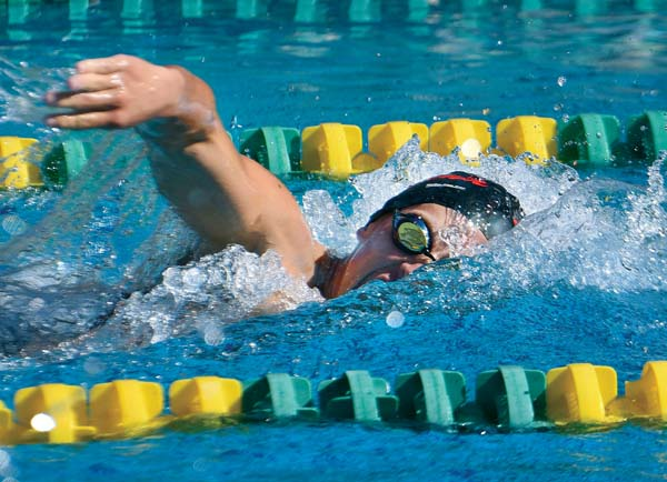 Lahaina Swim Club's Slater Fleck swims to a second-place finish in the boys 13-14 200 IM Saturday with a time of 2 minutes, 23.72 seconds. -- The Maui News / MATTHEW THAYER photo
