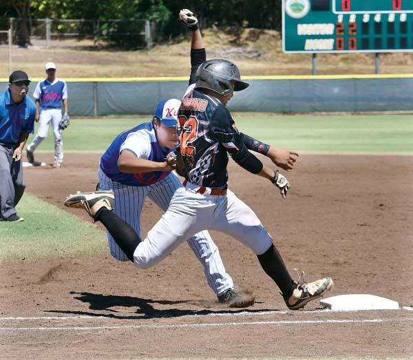 Kihei's Aizeah Lakalaka tags Ewa Beach's Sean Bentosino on a sacrifice bunt that brought in two runs in the third inning of Ewa's 7-1 win Saturday in a Hawaii State Little League Junior (13-14) Division tournament game at Maehara Stadium. -- The Maui News / MATTHEW THAYER photo