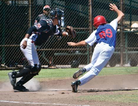 Kihei's Marcus Handley is run down by Ewa Beach catcher Caleb Lomavita in the third inning. -- The Maui News / MATTHEW THAYER photo
