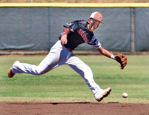 Ewa shortstop Zachary Takahama is unable to run down a ball hit for a third-inning single by Wyland Blair. -- The Maui News / MATTHEW THAYER photo