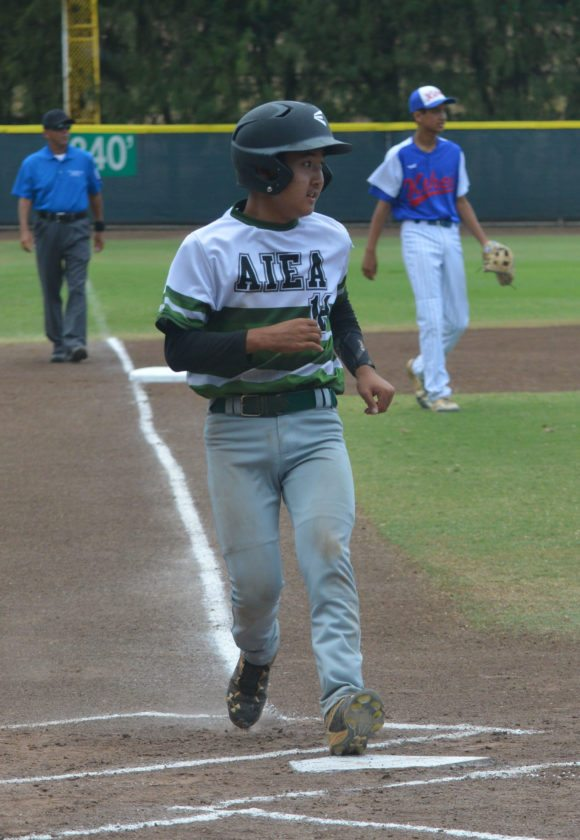 Michael Kawasaki scores a first-inning run for Aiea. • The Maui News/BRAD SHERMAN photo