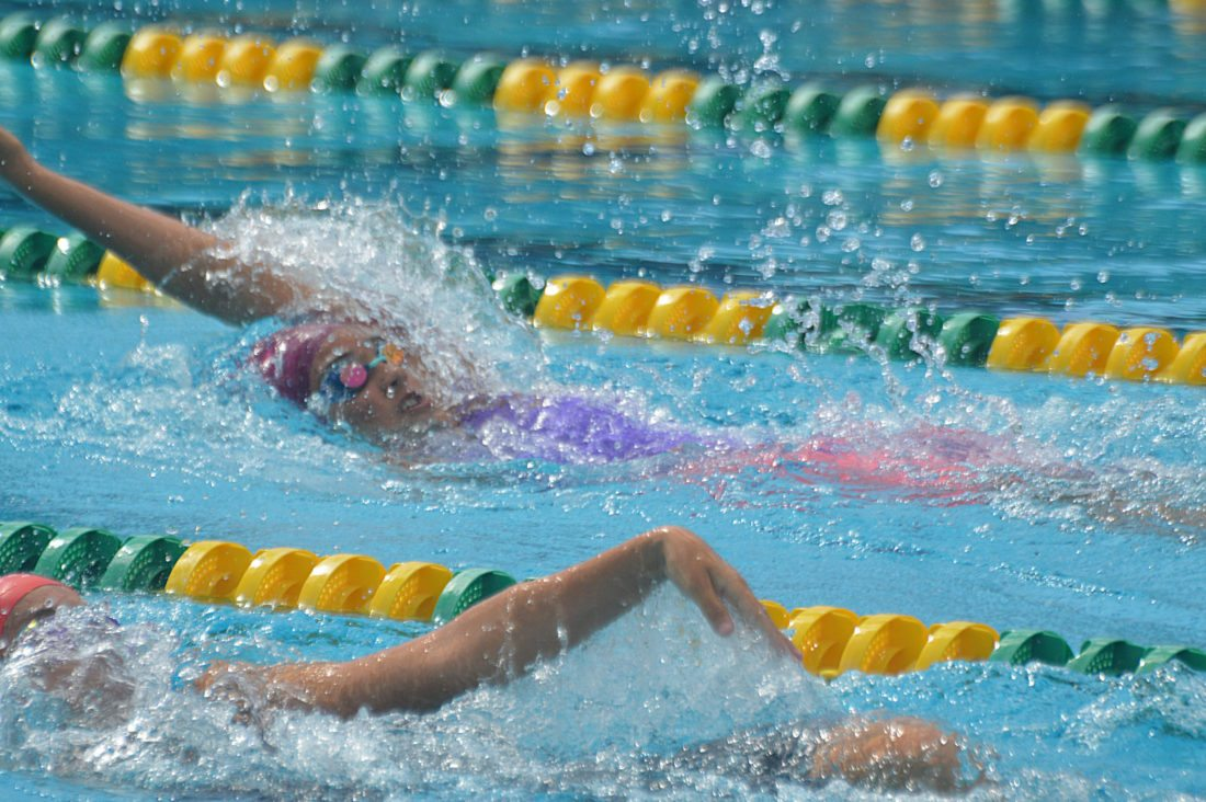Jordynn Brown of Hawaii Swim Club competes in the girls 13-14 100-meter backstroke Sunday at the state age-group championships at Kihei Aquatic Center. Brown won in 1 minute, 8.35 seconds. • The Maui News / ROBERT COLLIAS photo