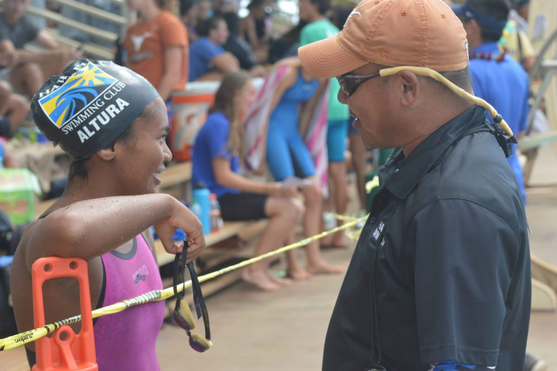 Kysha Altura talks with Hawaii Swim Club coach Reid Yamamoto on Sunday. • The Maui News / ROBERT COLLIAS photo