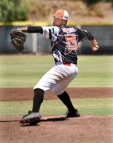Ewa Beach's Caleb Lomavita pitches in the fifth inning during his team's 17-2 win over Kaneohe in Tuesday's championship game of the Hawaii State Little League Junior (13-14) Division state tournament at Maehara Stadium. • The Maui News / MATTHEW THAYER photo