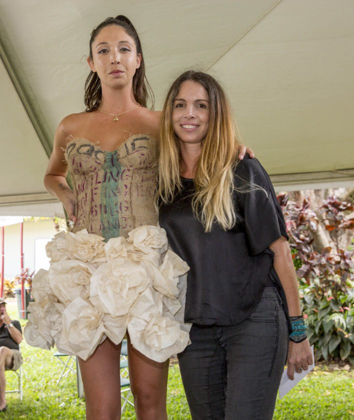 A previous year's model (left) poses with designer August Devenot in the Coffee Fashion Show. • Seed to Cup photo