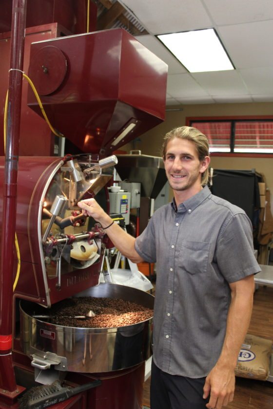 Roaster Tyler Shultz works the state-of-the-art machine in the Mill House Roasting Co. room at Maui Tropical Plantation. • The Maui News / CARLA TRACY photo