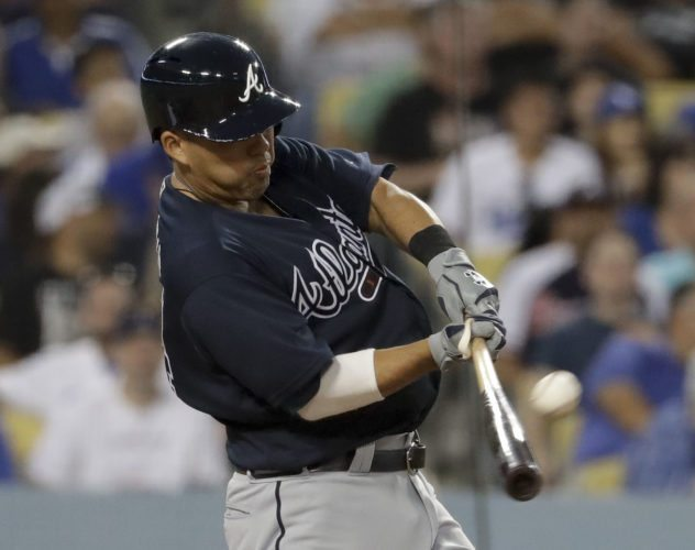 Atlanta's Kurt Suzuki homers during the fourth inning of the Braves' 6-3 victory over the Los Angeles Dodgers on Thursday. • AP photo
