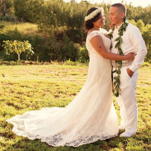 Senior Airman Kaiea Hokoana, 90th Security Forces Squadron installation patrolman, and Airman 1st Class Veulah Hokoana, 90th Force Support Squadron missile chef, pose for a wedding photo in Kula on Oct. 8, 2016. A week prior to the Hokoanas' wedding, they provided lifesaving assistance to a motorcyclist injured in an accident, which contributed to saving the man's life. Hokoana received the Air Force Commendation Medal for his actions during an award ceremony in Cheyenne, Wyo., on July 14.  -- Photo courtesy of U.S. Air Force