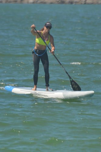 Andrea Moller arrives at Kahului Harbor to claim second place in the women's division of the Maui SUP Cup Poi Bowl Race on Sunday.  • The Maui News / BRAD SHERMAN photo