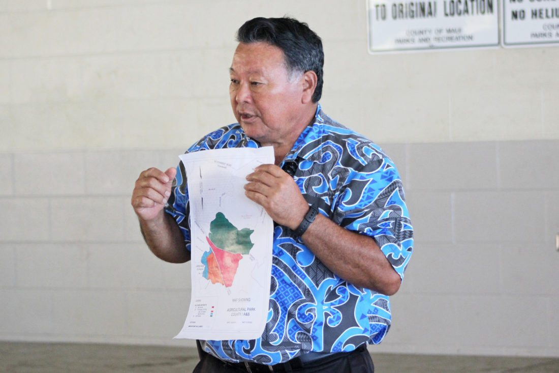 During a meeting at the Kula Community Center on Wednesday, Mayor Alan Arakawa points out the 869 acres that the county is thinking about purchasing to expand the Kula Agricultural Park. The county invited local farmers and ranchers to ask questions and offer their thoughts on the expansion. • The Maui News / COLLEEN UECHI photo