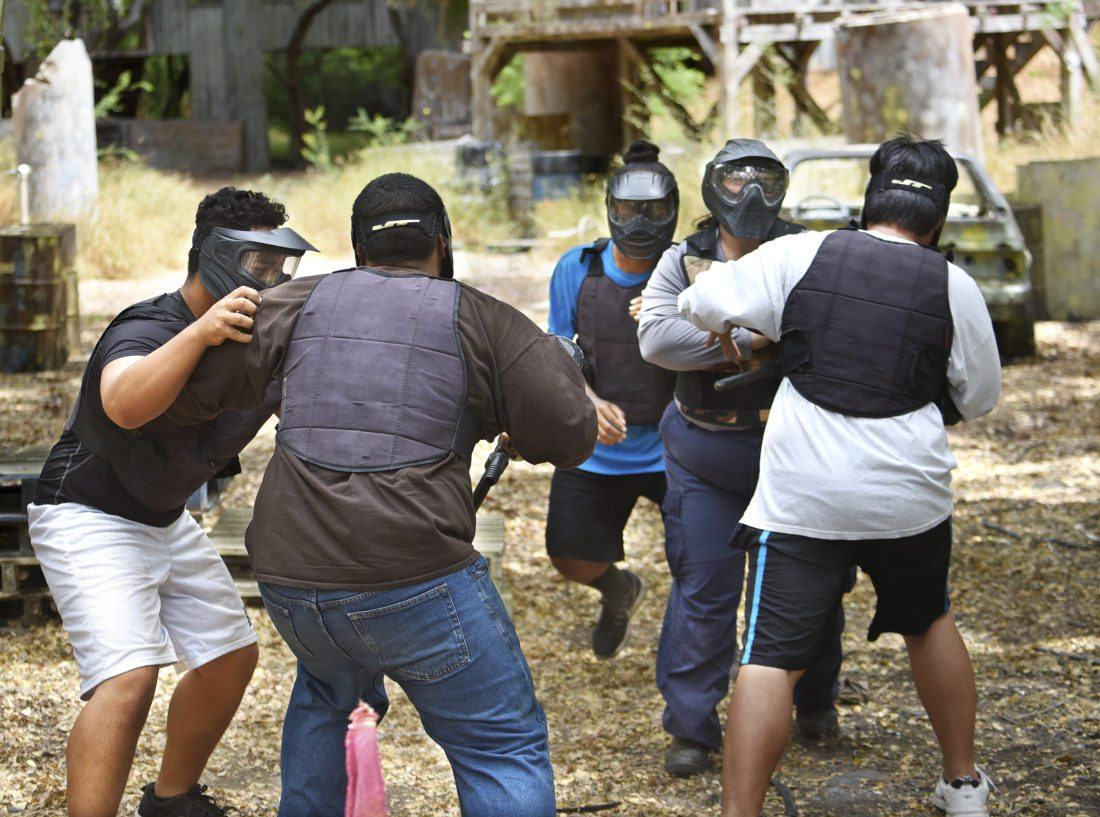 In a force continuum armed defense tactics drill, cadets (with backs to camera) Koapaka Purdy and Masahiko Masuda are attacked by Justin Pagaduan (from left), Ray Milovale and officer Nichole Comilang. The drill was designed to pressure the student officers in a high-stress situation that did not allow deadly force, as the assailants were unarmed. • The Maui News / MATTHEW THAYER photo