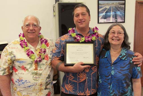 Na Hale O Maui Board President Michael Trotto (left) and Executive Director Cassandra Abdul present Bruce U'u with a Certificate of Appreciation for his many years of service on the NHOM board of directors.